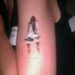 Space shuttle glitter tattoo
